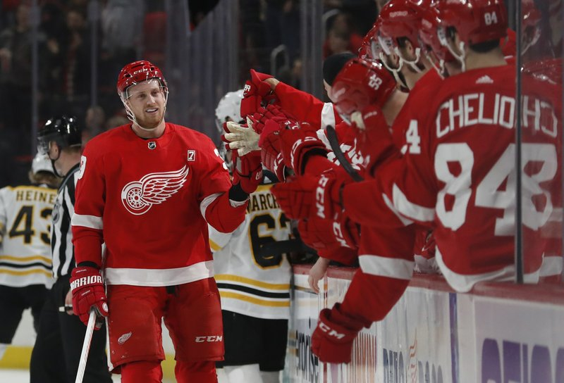 Detroit Red Wings right wing Anthony Mantha greets teammates after scoring during the first period of an NHL hockey game against the Boston Bruins, Sunday, March 31, 2019, in Detroit. (AP Photo/Carlos Osorio)