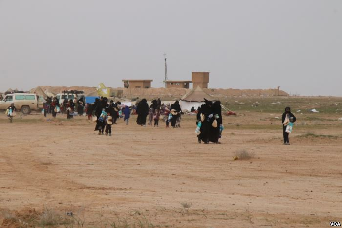 As women and children continue to evacuate Baghuz, aid organizations say they