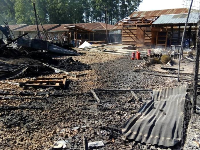 Burned structures are seen after attackers set fire to an Ebola treatment cen