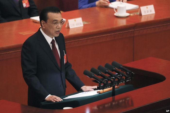 Chinese Premier Li Keqiang delivers his work reports at the opening session o