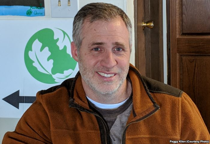 Chris Helzer, science director for Nature Conservancy of Nebraska, in describ