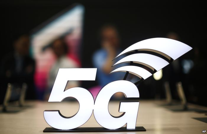 FILE - A banner of the 5G network is displayed during the Mobile World Congre