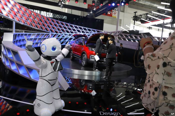 FILE - A robot entertains visitors at the booth of a Chinese automaker during