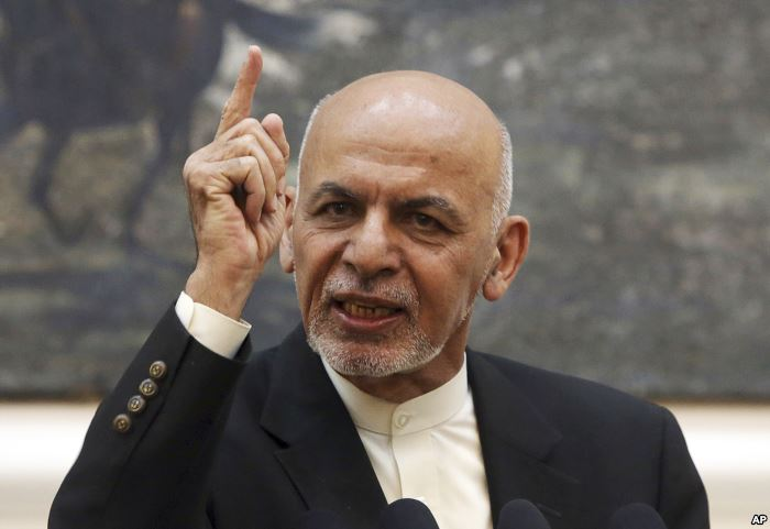 FILE - Afghan President Ashraf Ghani speaks during a press conference at the