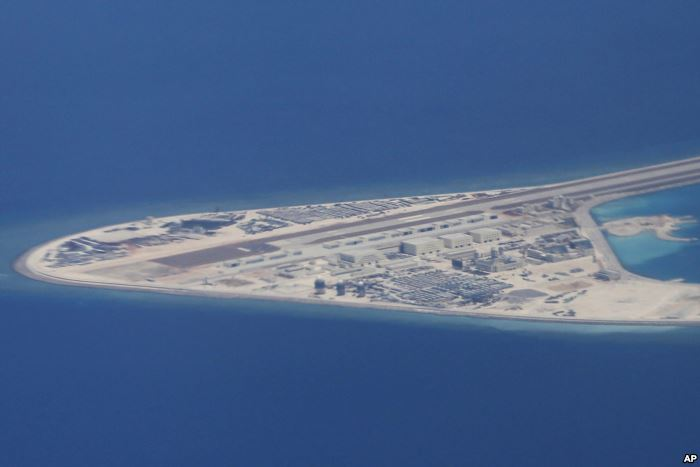 FILE - an airstrip, structures and buildings on China's man-made Subi Ree
