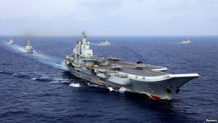 FILE - China's aircraft carrier Liaoning takes part in a military drill o