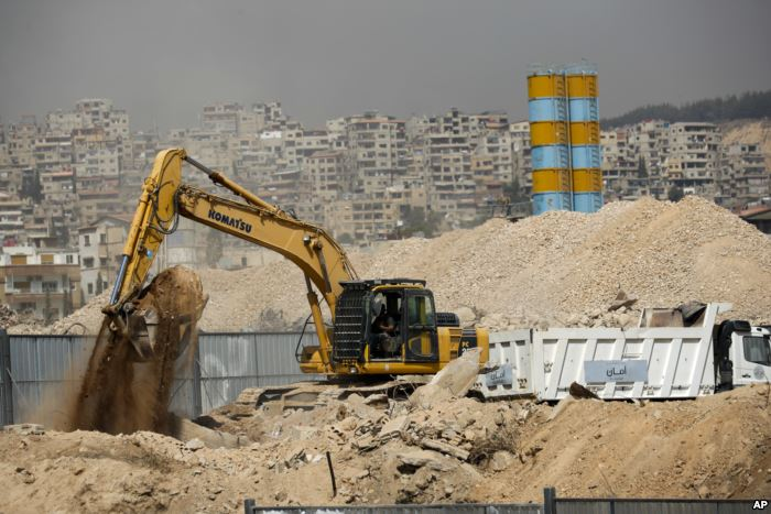 FILE - Heavy equipment works at a building site in southwestern Damascus, Syr