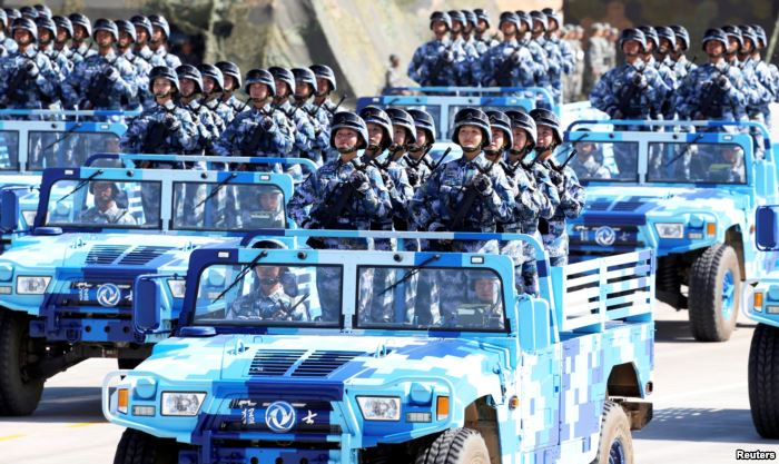 FILE - Soldiers of China's People's Liberation Army (PLA) take part i