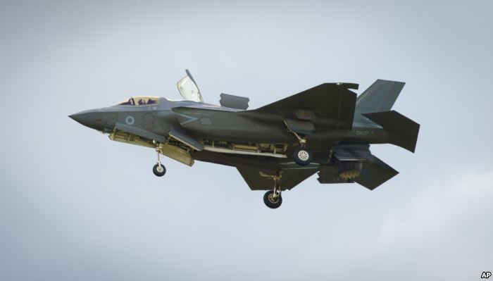 FILE - The F-35 Lightning II hovers in front of crowds during its first solo