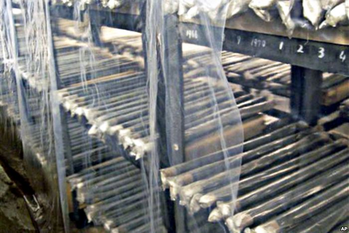 FILE - Unused nuclear fuel rods are piled on the shelves of a warehouse at No