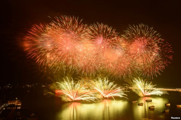 Fireworks light up the sky over Xiangzhou port of Zhuhai during a celebration