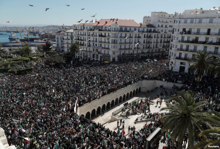 People gather during a protest over President Abdelaziz Bouteflika's deci