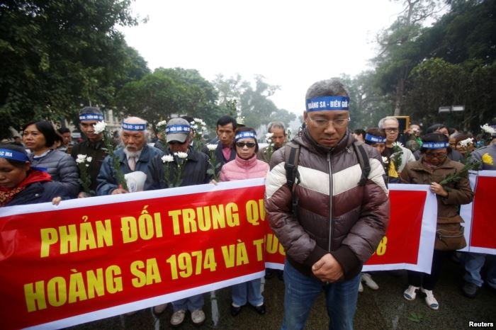 People take part in an anti-China protest to mark the 43rd anniversary of the