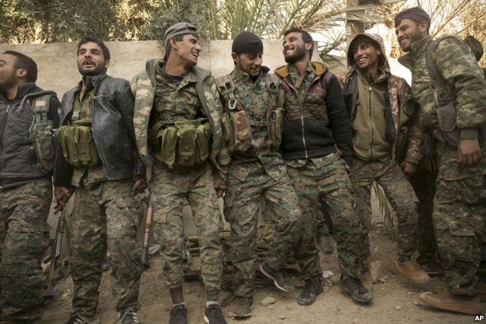 U.S.-backed Syrian Democratic Forces fighters celebrate their territorial gai