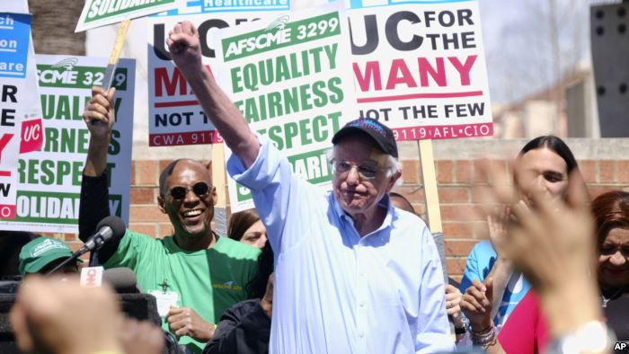 Vermont Sen. Bernie Sanders greets workers at a rally at the University of Ca