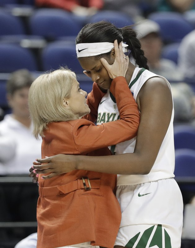 Baylor head coach Kim Mulkey, left, embraces Kalani Brown, right, as Brown leaves the game in the final minutes of the second half of a regional women's college basketball game against South Carolina in the NCAA Tournament in Greensboro, N. (AP Photo/Chuck Burton)
