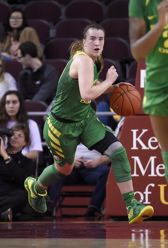 FILE - In this Jan. 11, 2019, file photo, Oregon's Sabrina Ionescu dribbles the ball during the first half of an NCAA college basketball game against Southern California, in Los Angeles. (AP Photo/Mark J. Terrill, File)