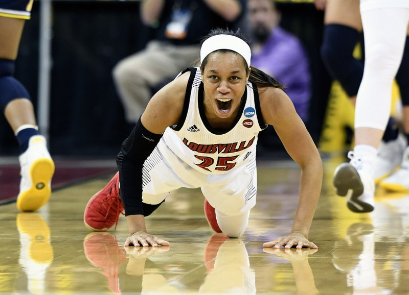 FILE - In this March 24, 2019, file photo, Louisville guard Asia Durr (25) shouts as she gets off the floor after being fouled during the first half of a second-round game against Michigan in the NCAA women's college basketball tournament, in Louisville, Ky. (AP Photo/Timothy D. Easley, File)
