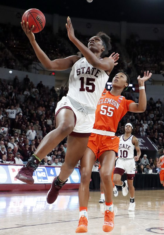 FILE - In this March 24, 2019, file photo, Mississippi State center Teaira McCowan (15) shoots a layup past Clemson forward Tylar Bennett (55) during the first half of a second-round women's college basketball game in the NCAA Tournament in Starkville, Miss. (AP Photo/Rogelio V. Solis, File)