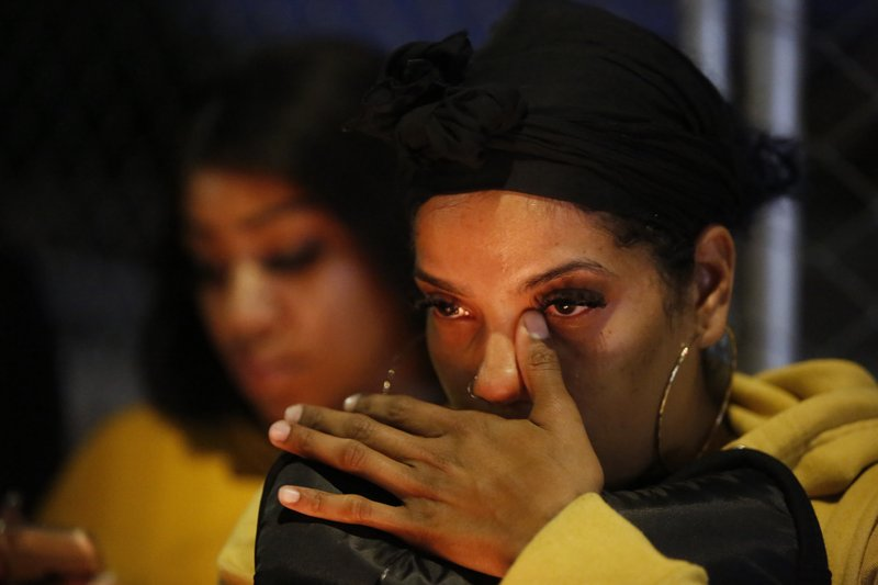 Jasmine Gurtrick, 26, from Compton, Calif., reacts to the fatal shooting of rapper Nipsey Hussle across from his clothing store in Los Angeles, Sunday, March 31, 2019. (AP Photo/Damian Dovarganes)