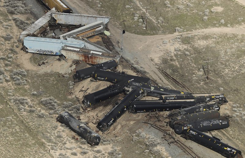 Twenty three Union Pacific train cars derailed, on Saturday, March 30, 2019, releasing an unknown quantity of propane after one car overturned about six to eight miles south of Eureka, Utah. (Jeffrey D. Allred/The Deseret News via AP)