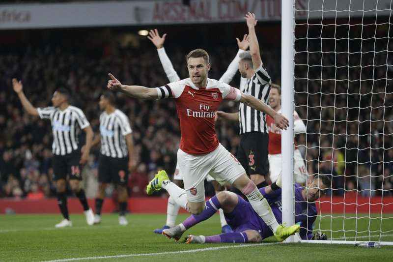 Arsenal's Aaron Ramsey celebrates before realizing his goal was disallowed during the English Premier League soccer match between Arsenal and Newcastle United at Emirates stadium in London, Monday, April 1, 2019. (AP Photo/Kirsty Wigglesworth)