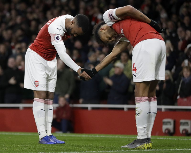 Arsenal's Alexandre Lacazette, left, celebrates scoring his side's second goal with Arsenal's Pierre-Emerick Aubameyang during the English Premier League soccer match between Arsenal and Newcastle United at Emirates stadium in London, Monday, April 1, 2019. (AP Photo/Kirsty Wigglesworth)