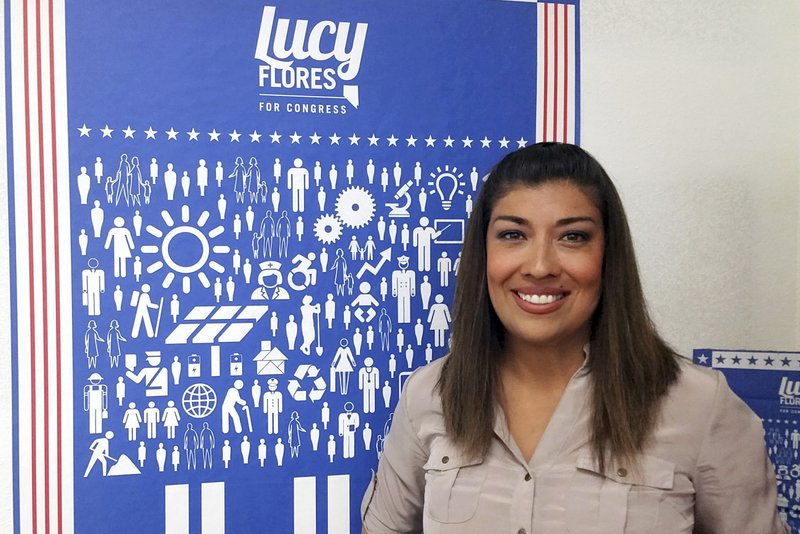 FILE - In this June 3, 2016, file photo, Lucy Flores poses for a photo at her North Las Vegas campaign headquarters. (AP Photo/Michelle Rindels, File)