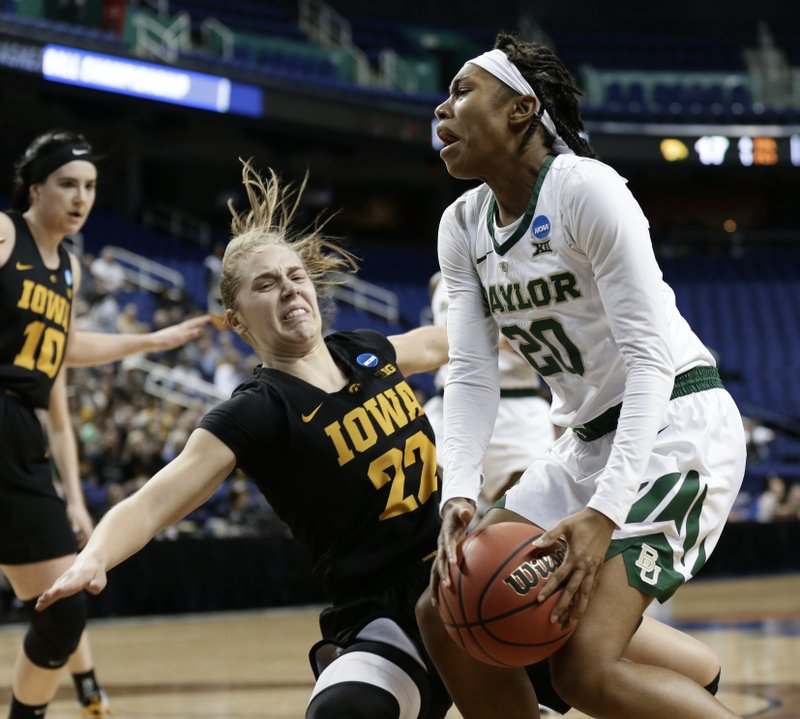 Baylor's Juicy Landrum (20) runs into Iowa's Kathleen Doyle (22) during the first half of a regional final women's college basketball game in the NCAA Tournament in Greensboro, N. (AP Photo/Gerry Broome)