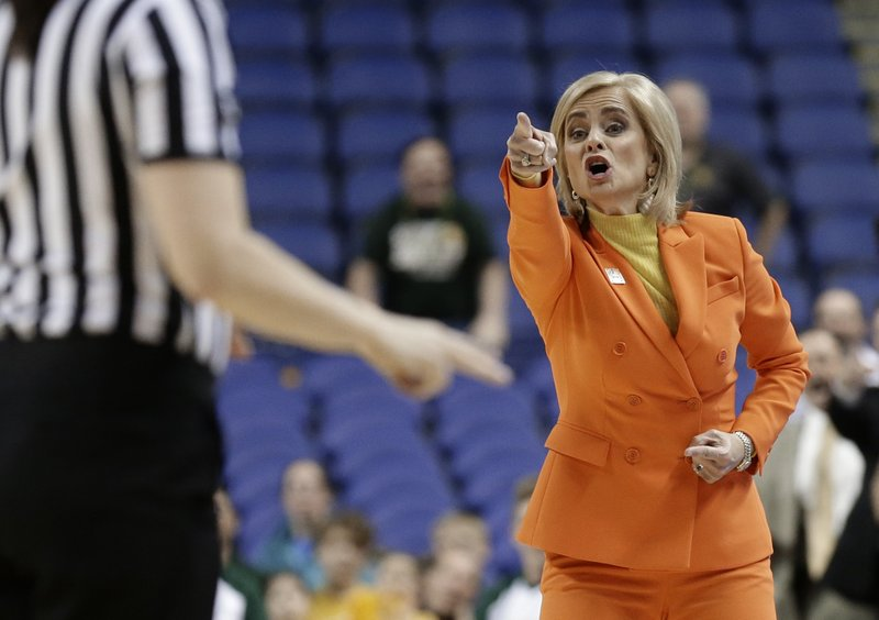 Baylor head coach Kim Mulkey argues a call during the first half of a regional final women's college basketball game against Iowa in the NCAA Tournament in Greensboro, N. (AP Photo/Gerry Broome)