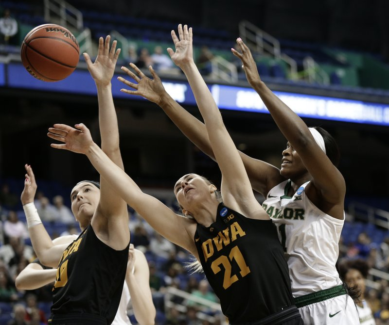 Baylor's Kalani Brown, right, battles Iowa's Hannah Stewart, center, and Megan Gustafson, left, during the first half of a regional final women's college basketball game in the NCAA Tournament in Greensboro, N. (AP Photo/Gerry Broome)