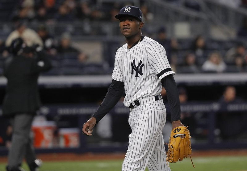 New York Yankees' pitcher Domingo German walks off the field after striking out Detroit Tigers' Niko Goodrum to end the top of the third inning of a baseball game, Monday, April 1, 2019, in New York. (AP Photo/Julie Jacobson)