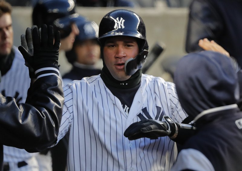 New York Yankees' Gary Sanchez celebrates with teammates in the dugout after hitting a solo home run against the Detroit Tigers during the second inning of a baseball game, Monday, April 1, 2019, in New York. (AP Photo/Julie Jacobson)