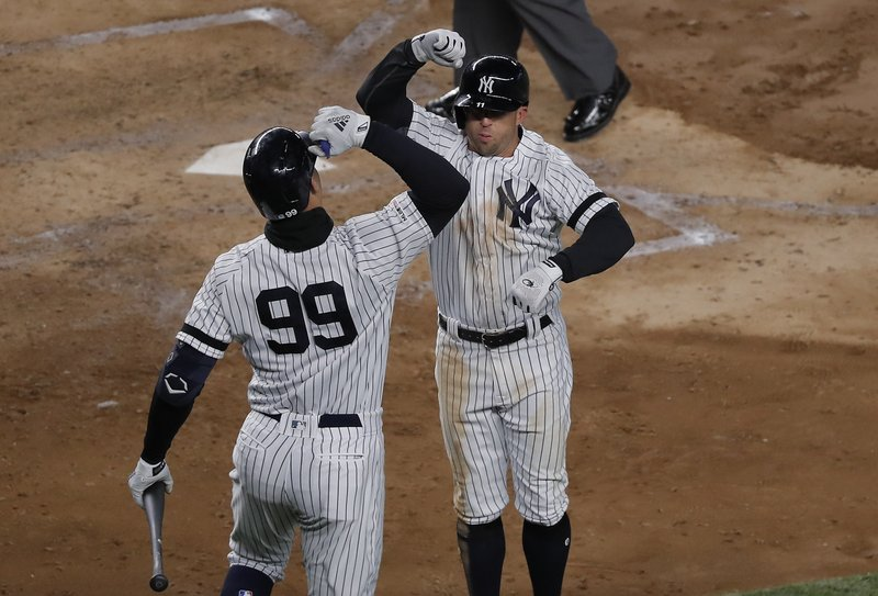 New York Yankees' Brett Gardner, right, celebrates with Aaron Judge (99) after hitting a solo home run against the Detroit Tigers during the fifth inning of a baseball game, Monday, April 1, 2019, in New York. (AP Photo/Julie Jacobson)