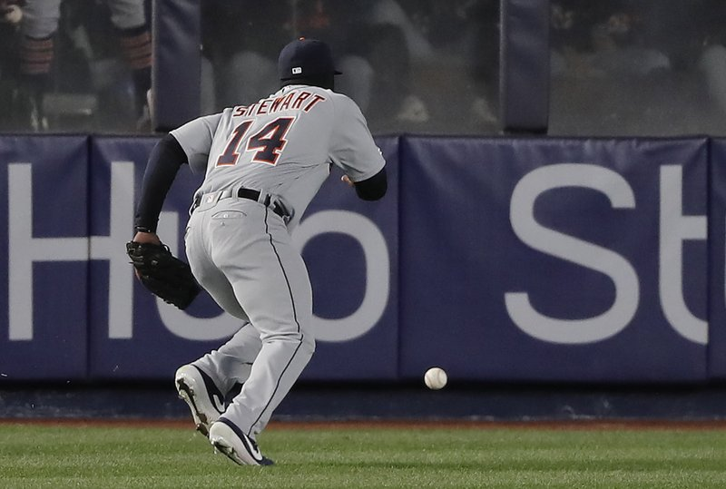 Detroit Tigers left fielder Christin Stewart (14) chases down the ball after committing a fielding error on a ball hit by New York Yankees' Greg Bird allowing a run to score during the third inning of a baseball game, Monday, April 1, 2019, in New York. (AP Photo/Julie Jacobson)