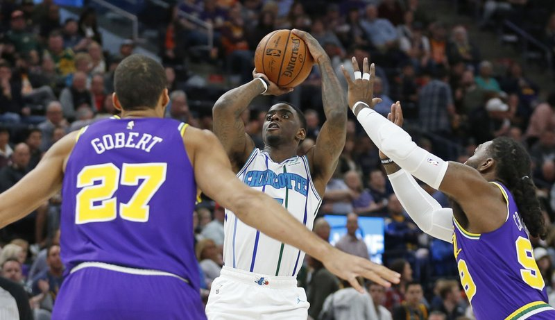 Charlotte Hornets guard Dwayne Bacon, center, shoots as Utah Jazz's Rudy Gobert (27) and Jae Crowder, right, defend during the first half of an NBA basketball game Monday, April 1, 2019, in Salt Lake City. (AP Photo/Rick Bowmer)