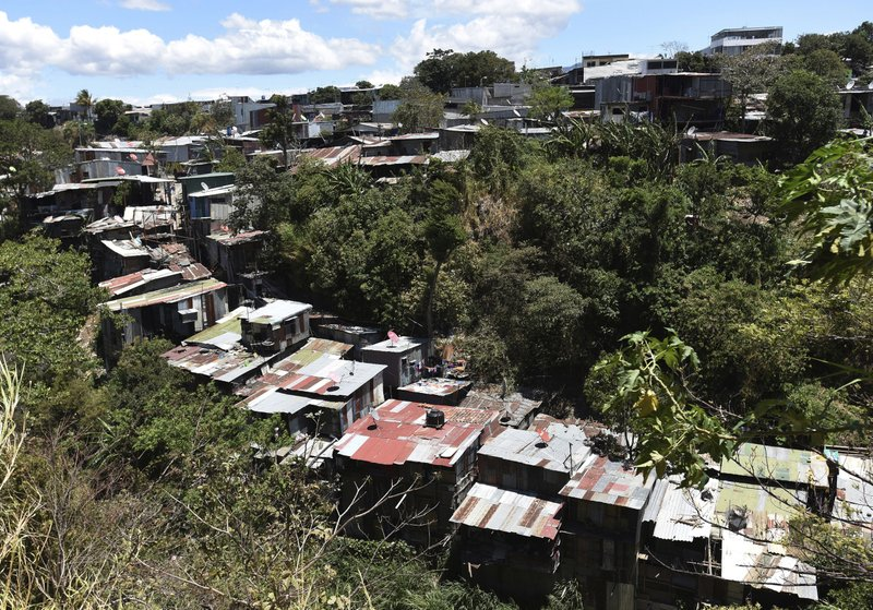 This March 29, 2019 photo shows a bird's eye view of La Carpio, a shantytown on the outskirts of San Jose, Costa Rica. (AP Photo/Carlos Gonzalez)