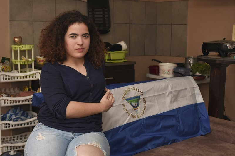 In this March 23, 2019 photo Nicaraguan exile Sadie Rivas, who was active in the protests to oust Daniel Ortega, poses for a photo in her home in San Jose, Costa Rica. (AP Photo/Carlos Gonzalez)