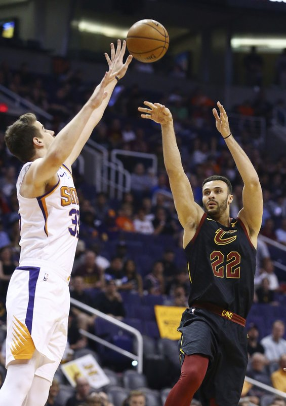 Cleveland Cavaliers forward Larry Nance Jr. (22) shoots over Phoenix Suns forward Dragan Bender, left, during the first half of an NBA basketball game Monday, April 1, 2019, in Phoenix. (AP Photo/Ross D. Franklin)