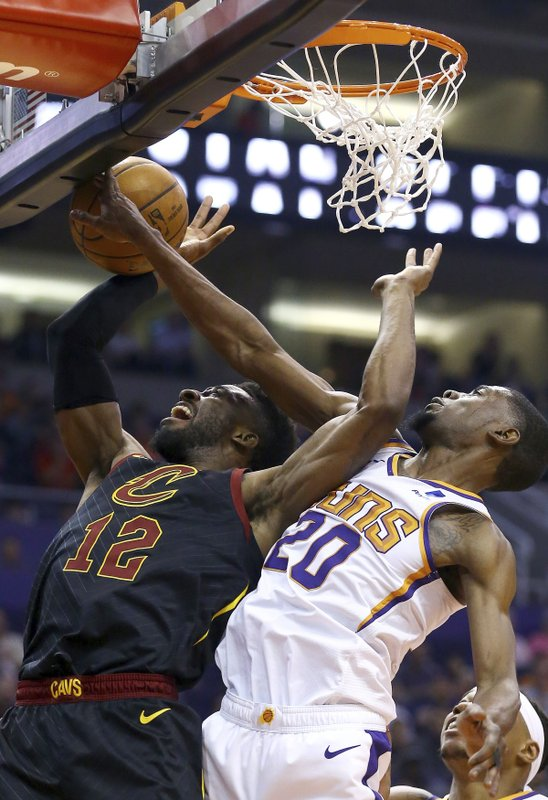 Cleveland Cavaliers guard David Nwaba (12) has his shot blocked by Phoenix Suns forward Josh Jackson (20) during the first half of an NBA basketball game Monday, April 1, 2019, in Phoenix. (AP Photo/Ross D. Franklin)