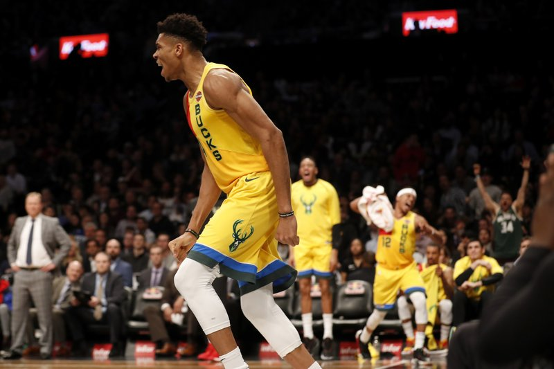 Milwaukee Bucks forward Giannis Antetokounmpo reacts after dunking during the second half of an NBA basketball game against the Brooklyn Nets, Monday, April 1, 2019, in New York. (AP Photo/Michael Owens)
