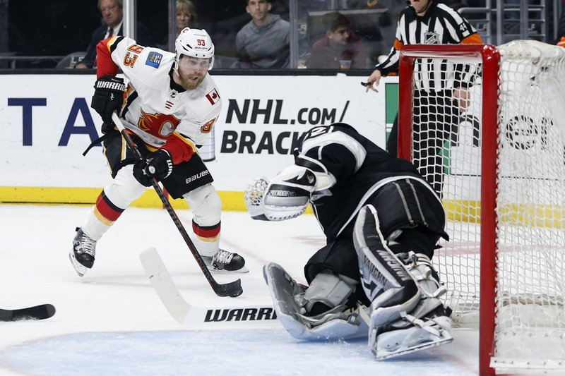 Calgary Flames forward Sam Bennett (93) tries to put a shot past Los Angeles Kings goalie Jonathan Quick (32) during the first period of an NHL hockey game Monday, April 1, 2019, in Los Angeles. (AP Photo/Ringo H.W. Chiu)
