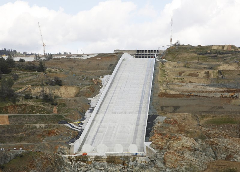 This Feb. 20, 2019, photo shows the Oroville Dam spillway in Oroville, Calif. California officials say the flood-control spillway at the nation's tallest dam is expected to be deployed as early as Tuesday, April 2, 2019, for the first time since it was rebuilt after it crumbled during heavy rains two years earlier, forcing nearly 2000,000 people to evacuate. (AP Photo/Rich Pedroncelli)