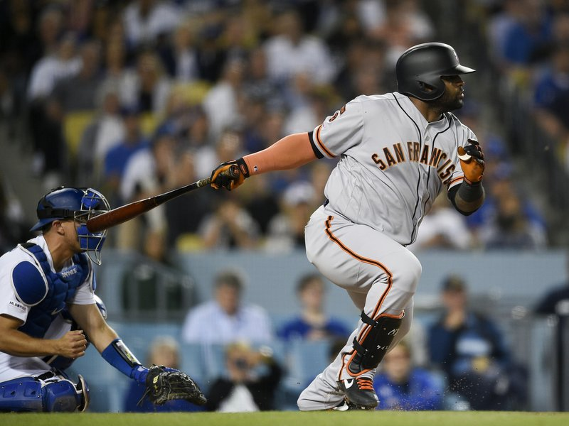 San Francisco Giants' Pablo Sandoval hits an RBI-single during the seventh inning of a baseball game against the Los Angeles Dodgers in Los Angeles, Monday, April 1, 2019. (AP Photo/Kelvin Kuo)