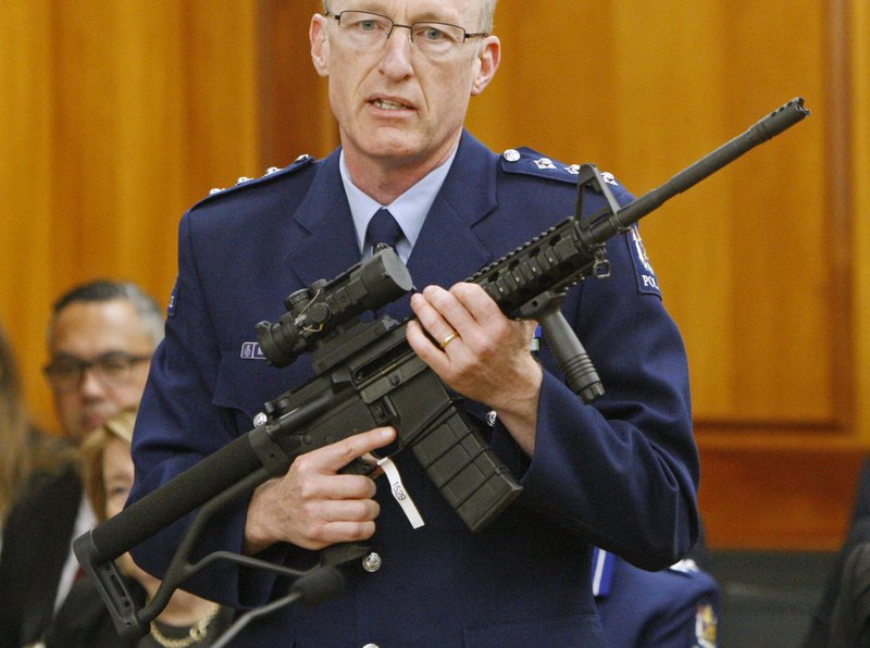 Police acting superintendent Mike McIlraith shows New Zealand lawmakers in Wellington, an AR-15 style rifle similar to one of the weapons a gunman used to slaughter 50 people at two mosques, Tuesday, April 2, 2019. (AP Photo/Nick Perry)
