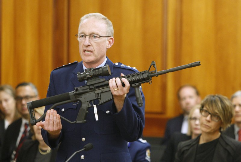 Police acting superintendent Mike McIlraith shows New Zealand lawmakers in Wellington on April 2, 2019, an AR-15 style rifle similar to one of the weapons a gunman used to slaughter 50 people at two mosques. (AP Photo/Nick Perry)