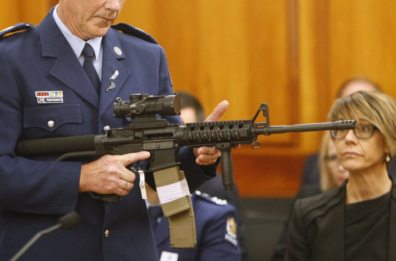Police Sr. Sgt. Paddy Hannan shows New Zealand lawmakers an AR-15 style rifle similar to one of the weapons a gunman used to slaughter 50 people at two mosques, in Wellington on April 2, 2019. (AP Photo/Nick Perry)