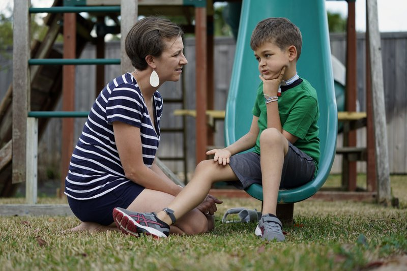 "Rachel Scott, left, talks with her son, Braden, in Tomball, Texas on Friday, March 29, 2019. ""Everyone is desperate for some magical thing"" to cure the kids, said Rachel. (AP Photo/David J. Phillip)"