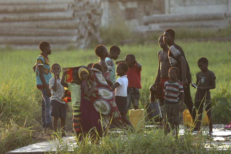 Children play at a watering point in Beira, Mozambique, Monday April, 1, 2019. The death toll from the cyclone has reached over 500, as Mozambican and international health workers raced on Monday to contain the outbreak of cholera in the cyclone-hit city of Beira and surrounding areas, where cases of the disease has jumped to more than 1,000. (AP Photo/Tsvangirayi Mukwazhi)