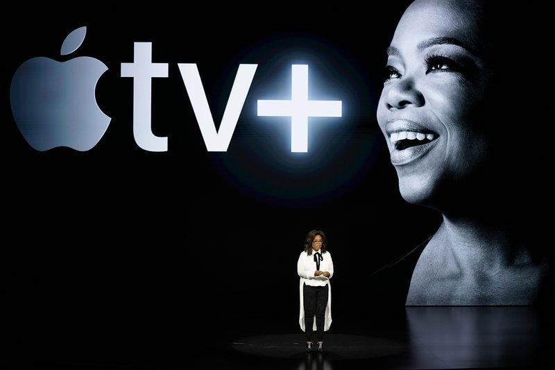 FILE - In this March 25, 2019 file photo, Oprah Winfrey speaks at the Steve Jobs Theater during an event to announce new Apple products, in Cupertino, Calif. (AP Photo/Tony Avelar, File)